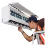 technician inspecting ductless system